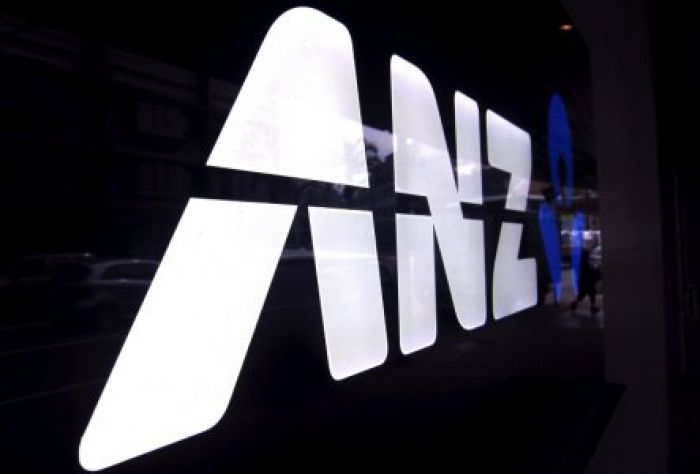 A man walks past a branch of the Australia and New Zealand Banking Group Ltd (ANZ) in Sydney Thomson Reuters