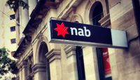 NAB's result was weighed down by restructuring charges and compensation costs.CREDIT:GLENN HUNT