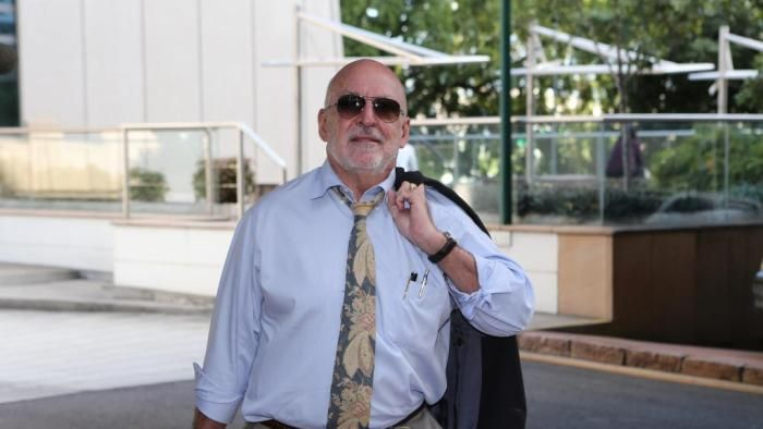 Federal Court Brisbane Sittings Storm Financial founder Emmanuel Cassimatis leaves court.