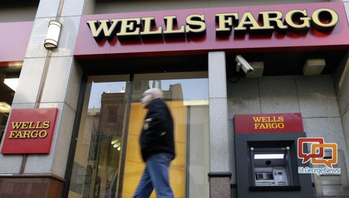In this 2012 file photo, a man walks past a Wells Fargo location in Philadelphia. The Federal Reserve is imposing more penalties on Wells Fargo, freezing the bank's growth until it can prove it has improved its internal controls. The new penalties were announced late Friday, Feb. 2, 2018, on Fed Chair Janet Yellen's last day at the central bank. Philadelphia, Pennsylvania, Dec. 19, 2012 | AP file photo by Matt Rourke, St. George News